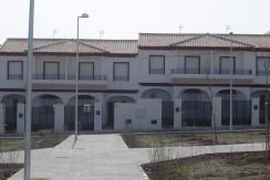 23 viviendas unifamiliares adosadas libres. Urbanización El Ejido